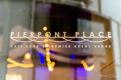 Photo of Pierpont Place logo on front door with lights reflecting